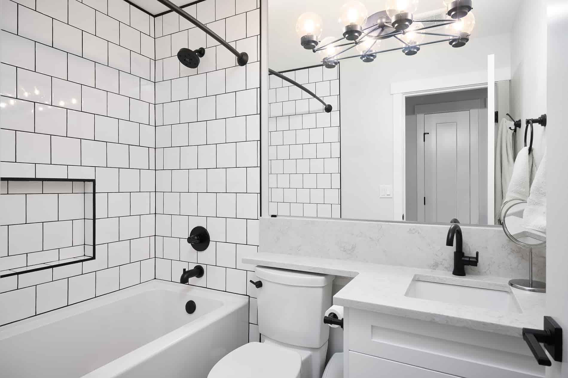 saskatchewan bathroom reno white subway tiles black grout and hardware