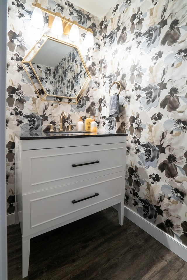 small bathroom with bold flower wallpaper