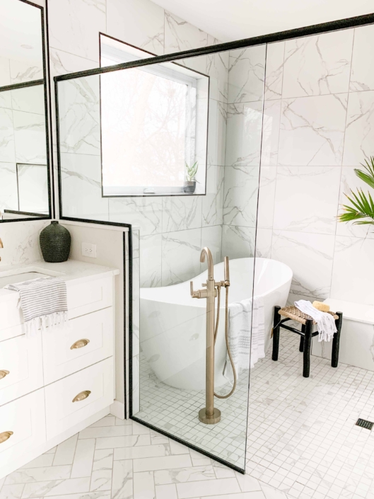 airy master bathroom with in shower freestanding bathtub and custom glass surround