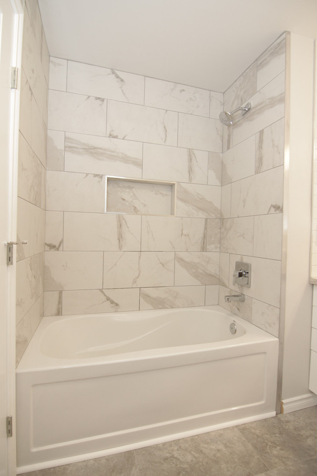 light and airy shower and tub with large carrara